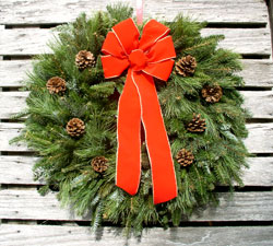 Mixed greens wreath with red ribbon